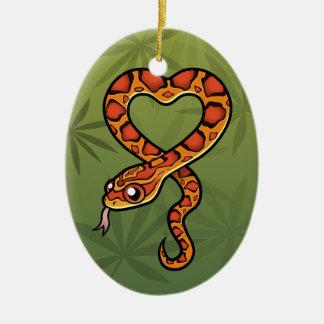 Serpiente del dibujo animado adorno navideño ovalado de cerámica