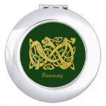 Serpiente irlandesa céltica del oro en acuerdo ver