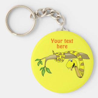 Serpiente linda del amarillo del dibujo animado en llaveros