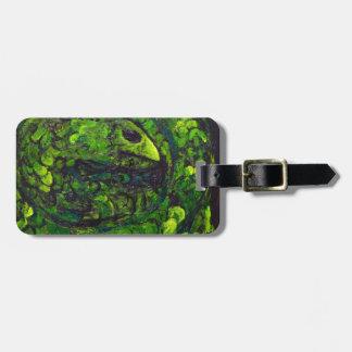Serpiente verde simbolismo animal oscuro etiqueta de maleta
