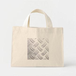 Serrated sheet background mini tote bag