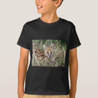 Serval cat relaxing in grass T-Shirt