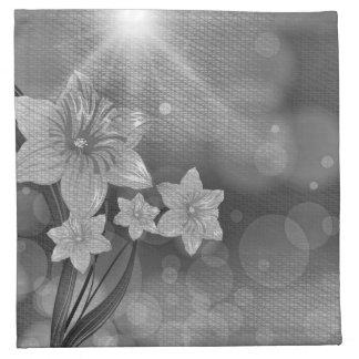 Servilletas blancos y negros del paño de la flor