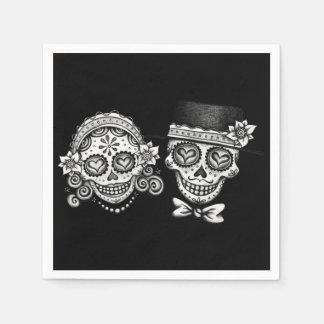 Servilletas de papel de los pares de los cráneos d