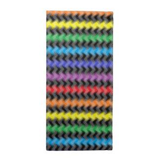 Servilletas torcidas del paño de los colores