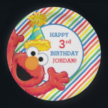 "Sesame Street | Elmo - Rainbow Birthday Paper Plate<br><div class=""desc"">Meet Elmo - the happiest little muppet you will ever see! The adorable Sesame Street character can be seen throwing his paws up in the air like he just doesn&#39;t care in this fun birthday design. Complete with colorful rainbow stripes, these cute paper plates are a must have accessory for...</div>"
