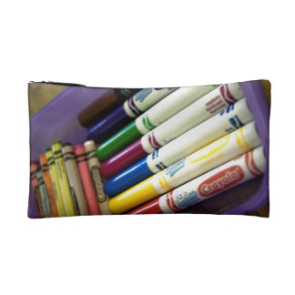 Set of crayons & seven different colored markers makeup bag