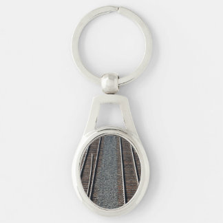 set of train tracks Silver-Colored oval metal keychain