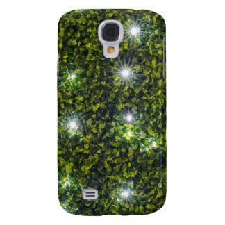 Seto verde de Privet con luz de las estrellas