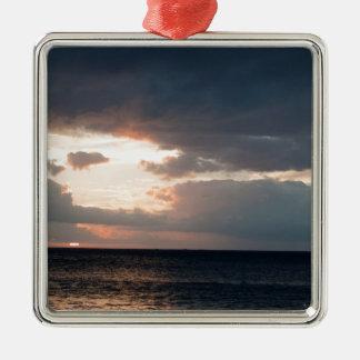 Setting sun over the ocean metal ornament