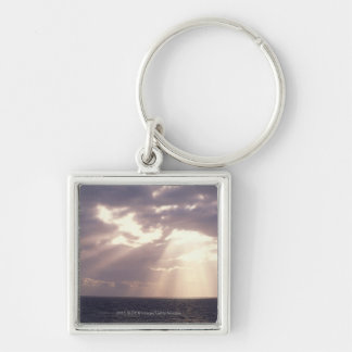 Setting sun shining through clouds over ocean Silver-Colored square keychain