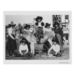 Seven rodeo cowgirls jokingly posing with a donkey print
