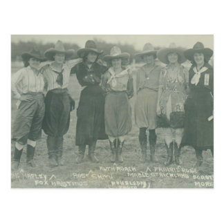 Seven rodeo cowgirls posing for a photograph. postcard
