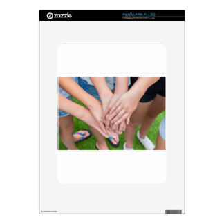Several arms of girls with hands over each other iPad skins