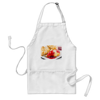 Several croissants with strawberry jam adult apron