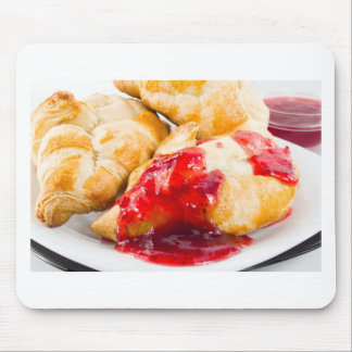 Several croissants with strawberry jam mouse pad