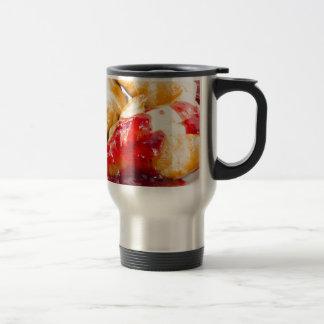 Several croissants with strawberry jam travel mug