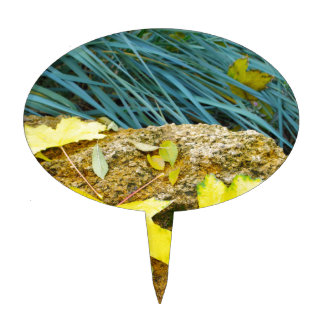 Several yellow autumn leaves with a blurred backgr cake topper