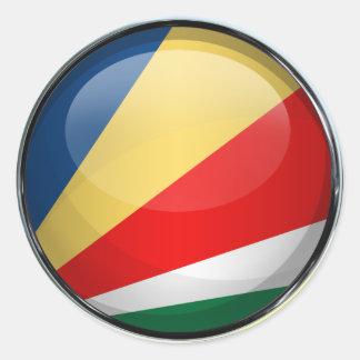 Seychelles señalan la bola por medio de una pegatina redonda