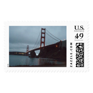 SF GOLDEN GATE BRIGE SUPPORTED ON A ROCK STAMP