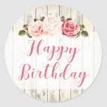 """Shabby Chic Roses Rustic Wood Happy Birthday Classic Round Sticker<br><div class=""""desc"""">Elegantly shabby and rustic! This sweet birthday design features beautiful pink and cream roses on light rustic wood. Gracefully stylish for a feminine birthday celebration at any age!  • Browse the Shabby Pink Rose Birthday Collection below for all coordinating party supplies,  including invitations,  gift bags,  plates and more!</div>"""