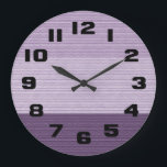 "Shades of Purple Large Clock<br><div class=""desc"">This unique wall clock features three shades of purple on a quilted brick background,  surrounded by big,  bold,  black numbers.</div>"