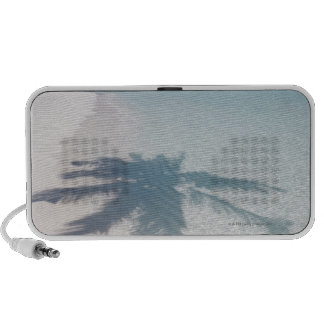 Shadow of a palm tree on a deserted island beach portable speaker