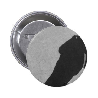 Shadow of a photographer on the sand beach pinback button
