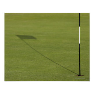 shadow of golf flag on golf course green poster