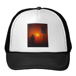 Shadow of the man who photographed road sign trucker hat