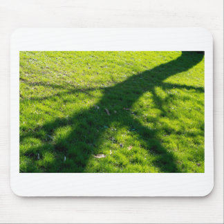 Shadow of the tree at the spring grass mouse pad