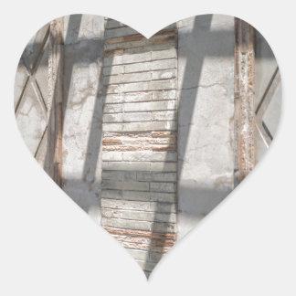 Shadows Against A Wall Heart Sticker