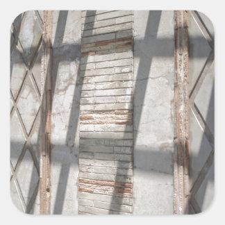 Shadows Against A Wall Square Sticker