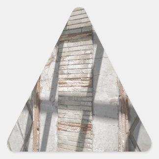 Shadows Against A Wall Triangle Sticker