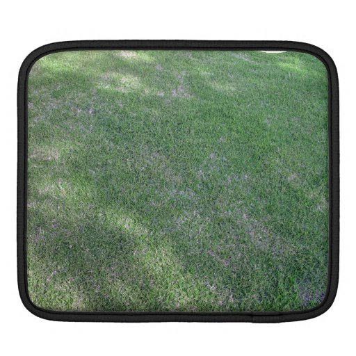 Shady green lawn for background iPad sleeves