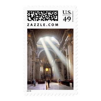 Shafts of sunlight pour through the windows postage