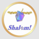 "Shalom Hanukkah Classic Round Sticker<br><div class=""desc"">Rich blue and gold Hanukkah design with Dreidel and gold coins. Text says..Shalom.</div>"