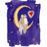 """Share Our Joy Grooms on Moon Cutout<br><div class=""""desc"""">A cute image appropriate for an engagement,  wedding or commitment ceremony. A cute male couple sits in a whimsical crescent moon with a heart dangling from the end.</div>"""