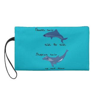 Shark moves vs. dolphin moves wristlet purse