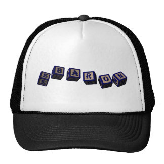Sharon toy blocks in blue trucker hat