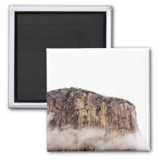 Sheer cliff rising above clouds 2 inch square magnet