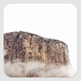 Sheer cliff rising above clouds square sticker