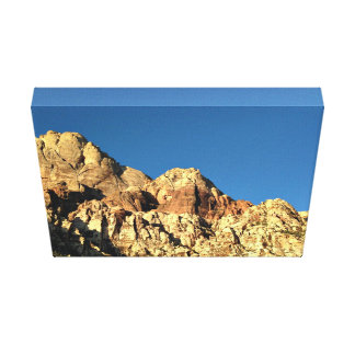 Sheer rock face and blue sky canvas print