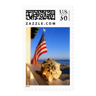 Shell On Porch Railing With American Flag Postage