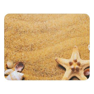 Shells on the beach door sign