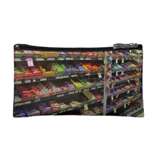 Shelves of chocolate bars in store makeup bags