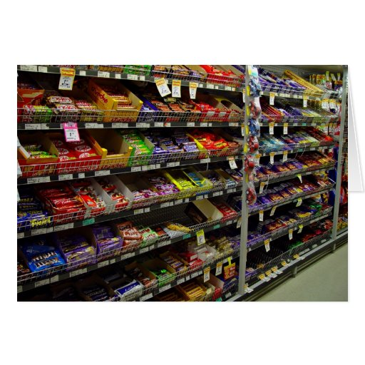 Shelves of chocolate bars in store greeting card