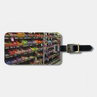 Shelves of chocolate bars in store bag tags