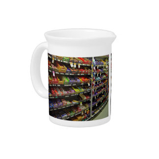Shelves of chocolate bars in store beverage pitcher