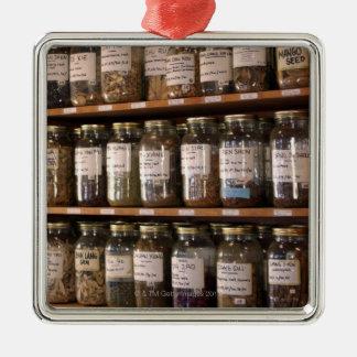 Shelves of herb jars metal ornament